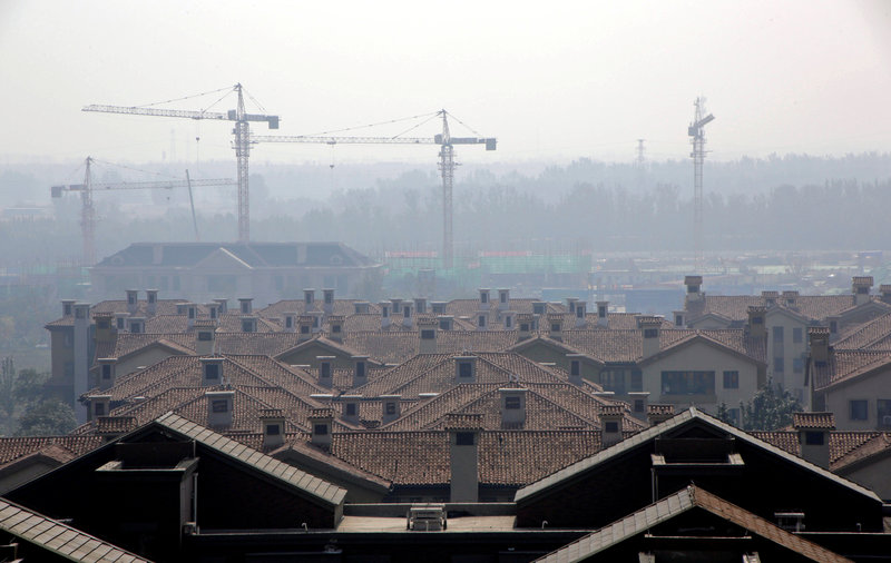 FILE PHOTO: Apartment blocks are pictured in Wuqing District of Tianjin