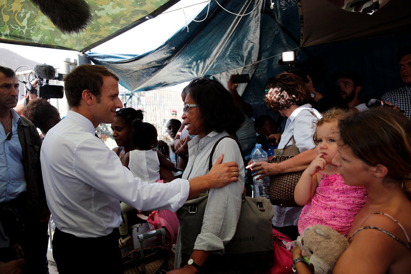 France's President Emmanuel Macron comforts residents during his visit to the French Caribbean island of St. Martin