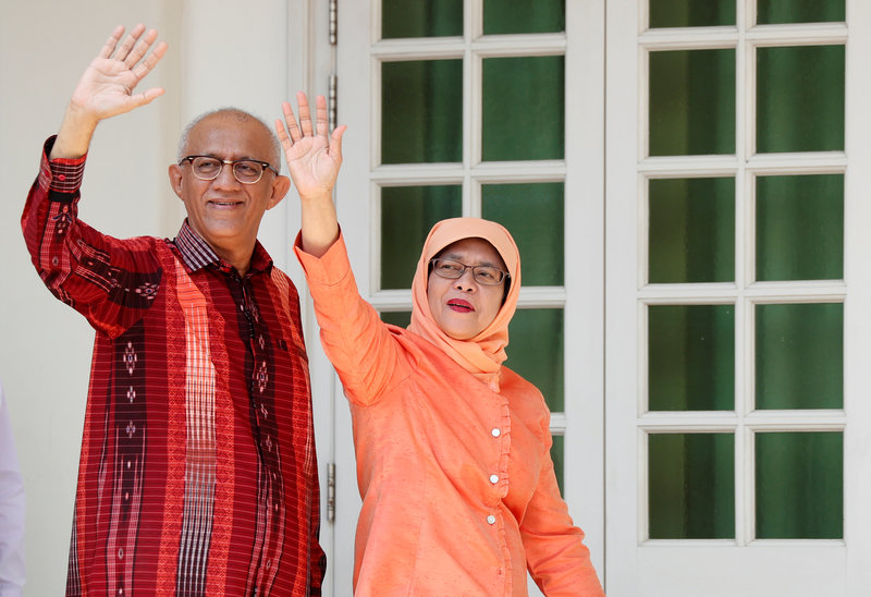 Former speaker of Singapore's parliament, Halimah Yacob, arrives to submit her presidential nomination papers at the nomination centre in Singapore