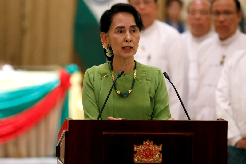 FILE PHOTO: Myanmar State Counselor Aung San Suu Kyi talks during a news conference with India's Prime Minister Narendra Modi in Naypyitaw