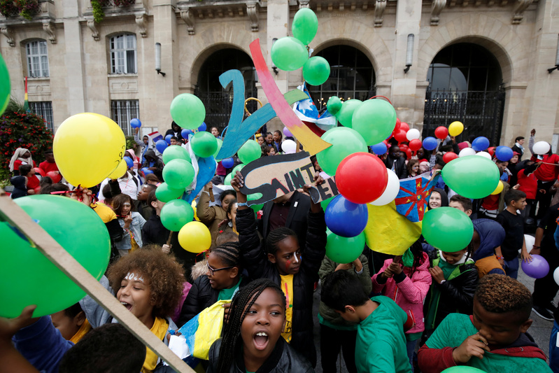Children of Saint-Denis celebrate before the Paris bids results to host the 2024 Olympic and Paralympic Games in Saint-Denis near Paris