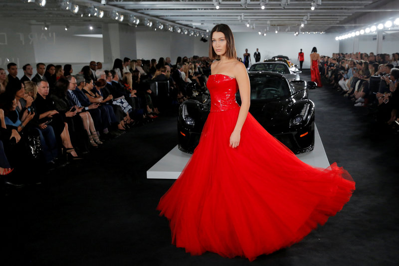 Model Bella Hadid presents a creation from the Ralph Lauren Spring/Summer 2018 collection in a show that was presented in Lauren's private garage for New York Fashion Week in Manhattan