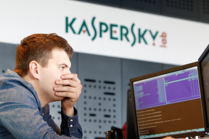 FILE PHOTO: An employee works near screens in the virus lab at the headquarters of Russian cyber security company Kaspersky Labs in Moscow