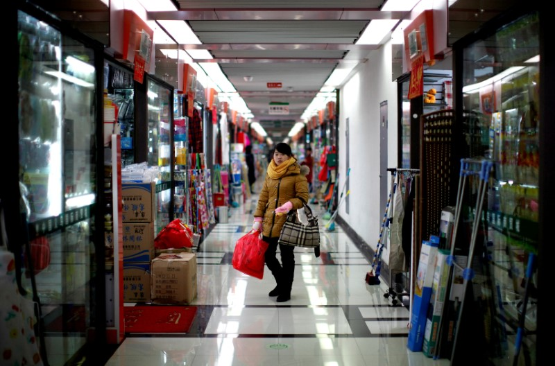 FILE PHOTO: A woman pauses as she shops at a wholesale market in Yiwu