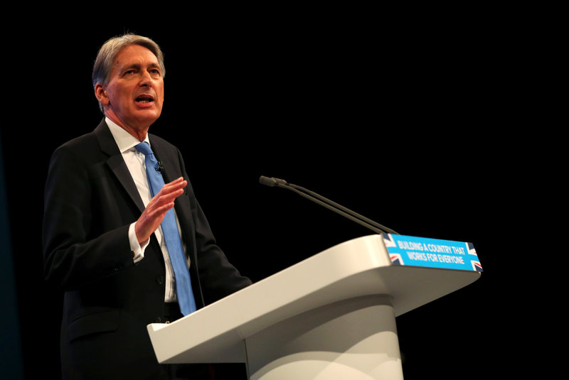 Britain's Chancellor of the Exchequer Philip Hammond speaks at the Conservative Party's conference in Manchester