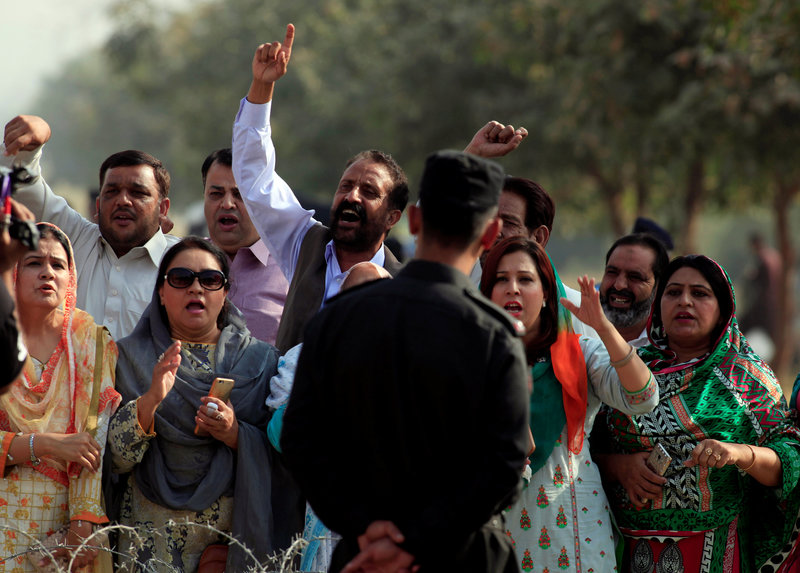 Supporters from the ruling Pakistan Muslim League-Nawaz (PML-N) chant slogans outside National Accountability Bureau (NAB) court in Islamabad