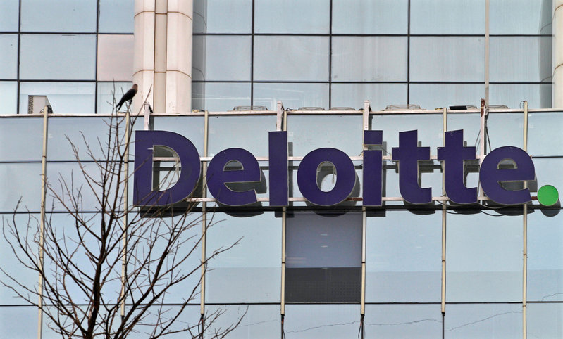 FILE PHOTO: The Deloitte Company logo is seen on a commercial tower at Gurgaon
