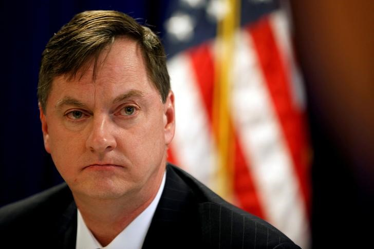 FILE PHOTO: Chicago Federal Reserve Bank President Evans takes a question during a round table with the media in Shanghai