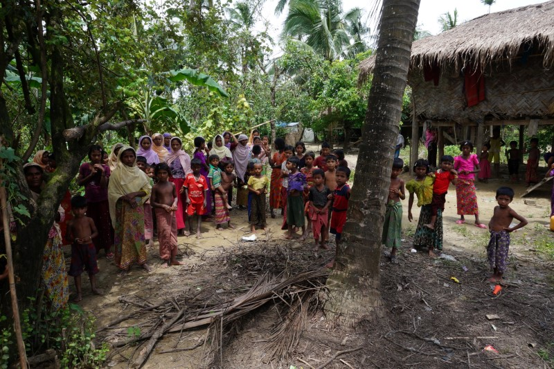 Rohingya villagers watch as international media visit Maung Hna Ma village,  Buthidaung township, northern Rakhine state, Myanmar