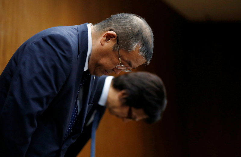 Kobe Steel Ltd Managing Executive Officer Katsukawa bows with other executive during a news conference in Tokyo