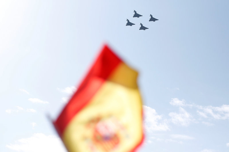 Four Eurofighter jets take part in a flypast as part of celebrations to mark Spain's National Day in Madrid