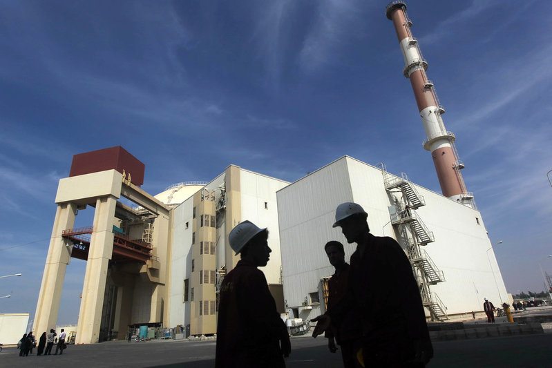 FILE PHOTO: Iranian workers stand in front of Bushehr nuclear power plant, 1,200 km south of Tehran