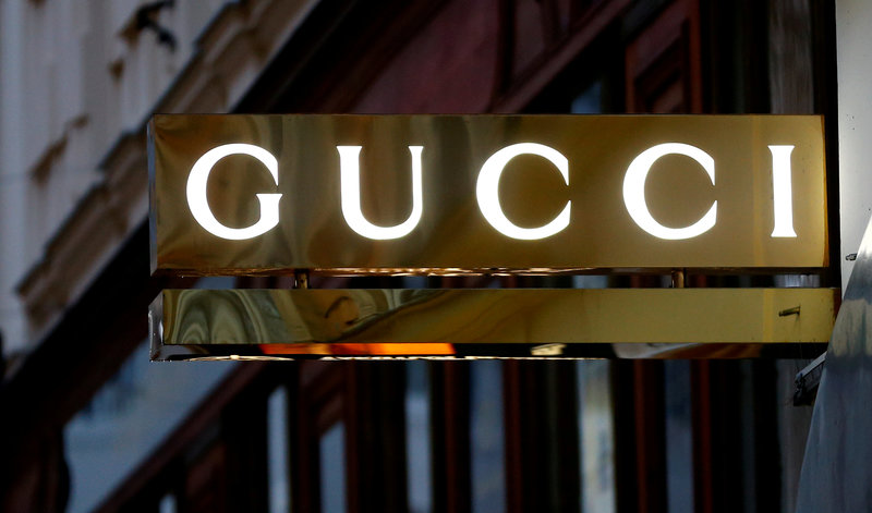 FILE PHOTO: A company logo is pictured outside a Gucci store in Vienna