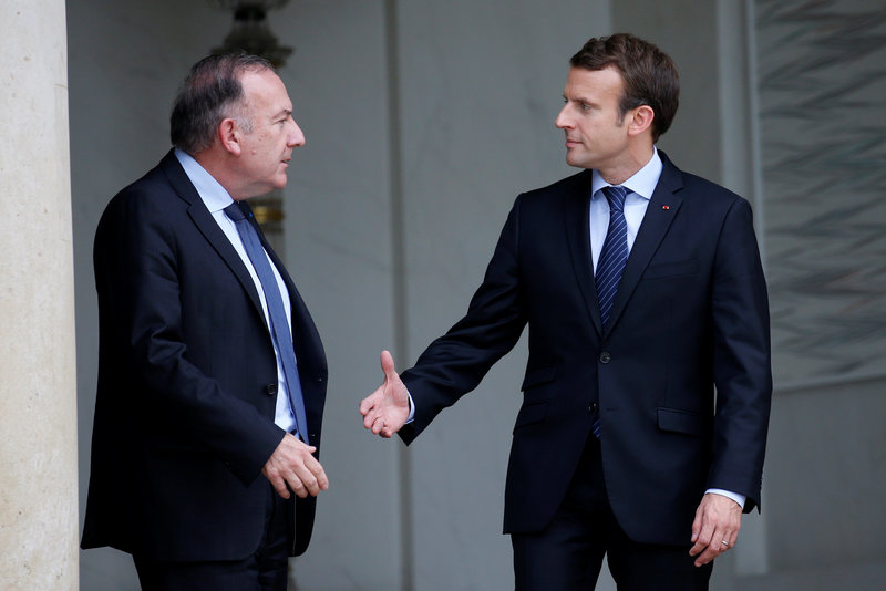 French President Emmanuel Macron accompanies French employer's body MEDEF union leader Pierre Gattaz after a meeting at the Elysee Palace in Paris