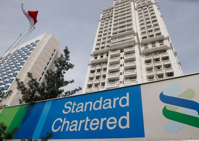 FILE PHOTO: A Standard Chartered sign is seen outside of a building, with a branch of the bank, in Jakarta, Indonesia