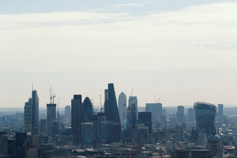 FILE PHOTO: A view of the City of London and Canary Wharf.