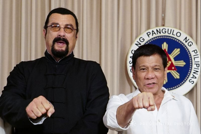 President Rodrigo Duterte with visiting American actor Steven Seagal (L) gestures during his courtesy call at the Malacanang presidential palace in Manila