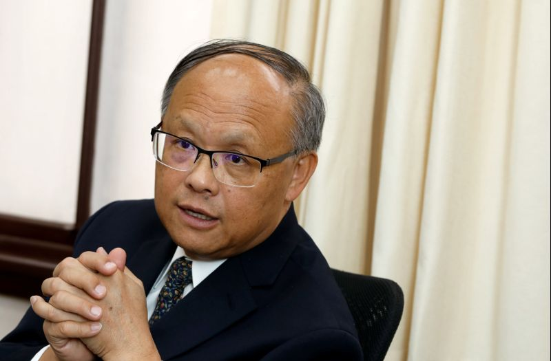 Taiwanese Executive Yuan Minister John Deng speaks during an interview with Reuters in Taipei