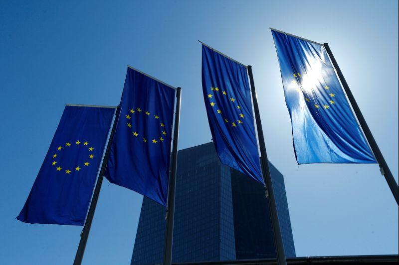FILE PHOTO: European Union flags flutter outside the headquarters of ECB in Frankfurt
