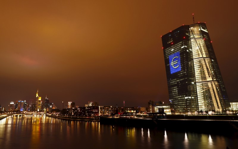 The head quarter of the European Central Bank (ECB) is illuminated with a giant euro sign at the start of the