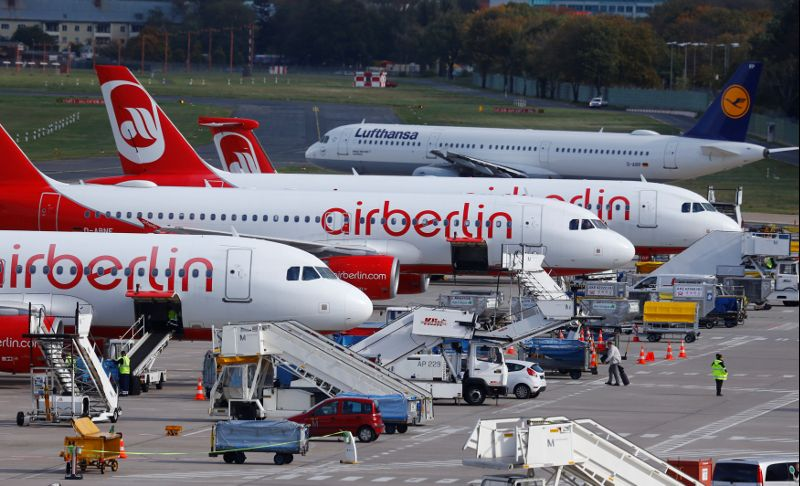 A Lufthansa airliner taxis next to the Air Berlin aircrafts at Tegel airport in Berlin