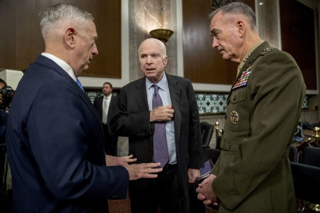 Top military officials endorse staying in Iran deal, contradicting Trump