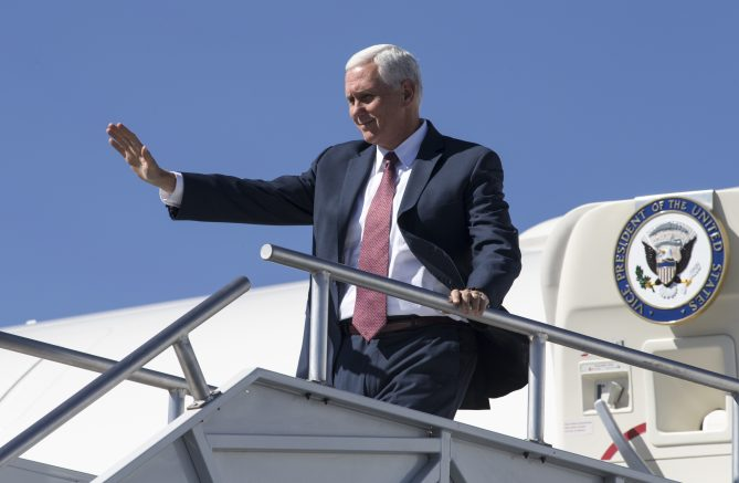 Vice President Mike Pence waves from Air Force Two