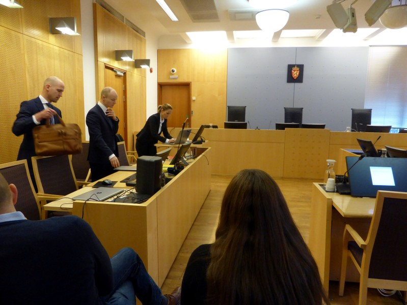 The prosecution team in the Ola Rollen insider trading case trial arrives at the district court in Oslo