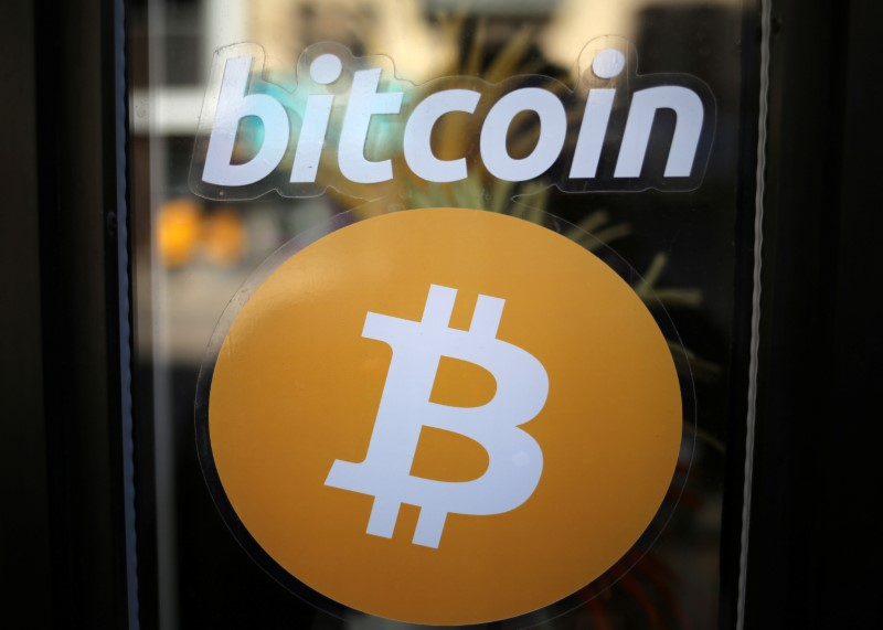 FILE PHOTO: A sign is seen outside a business where a Bitcoin ATM is located in Toronto
