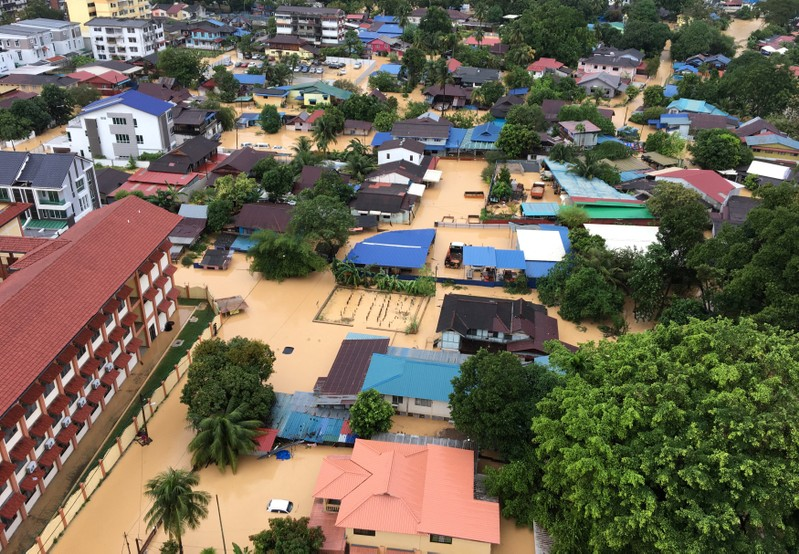 An aerial view shows the flooded residential area in George Town