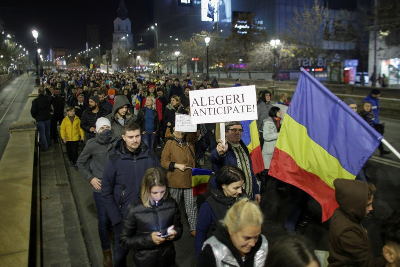 People march in protest against the ruling Social Democrats' plans to overhaul judicial legislation in Bucharest