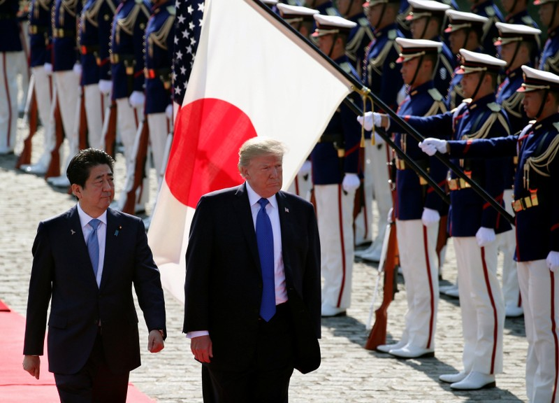 U.S. President Donald Trump reviews an honor guard during a welcome ceremony with Japanese Prime Minister Shinzo Abe at Akasaka State Guest House in Tokyoelcome ceremony at Akasaka State Guest House in Tokyo