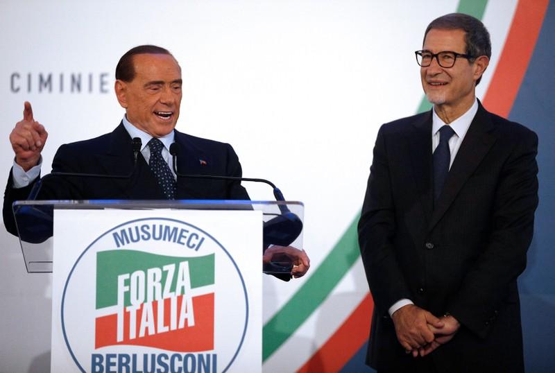 Forza Italia party leader Silvio Berlusconi speaks next to local candidate Nello Musumeci during a rally in Catania