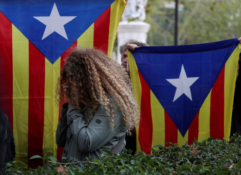 Supporters of dismissed Catalan Cabinet members react outside  Spain's High Court in Madrid