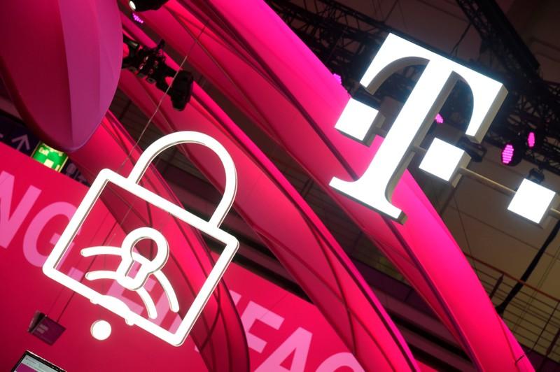 FILE PHOTO: Deutsche Telekom logo is seen during preparations at the CeBit computer fair in Hanover