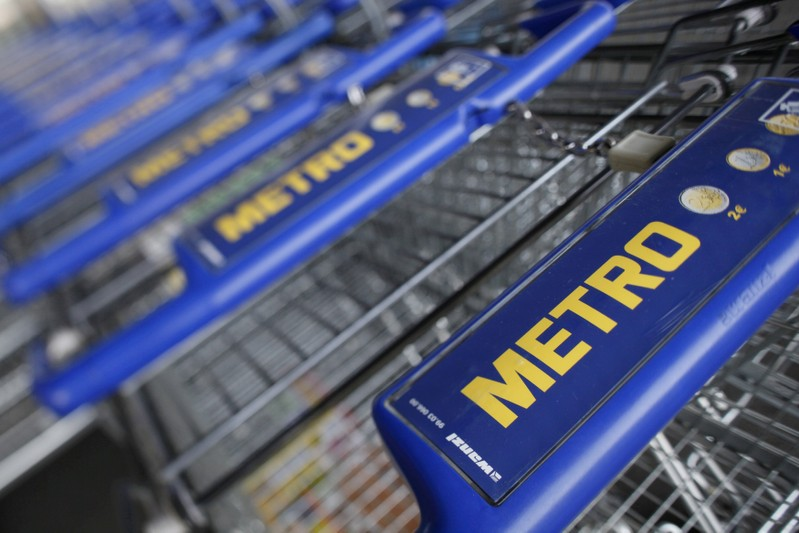 FILE PHOTO: File photo of shopping carts of Germany's biggest retailer Metro AG lined up at a Metro cash and carry market in St. Augustin