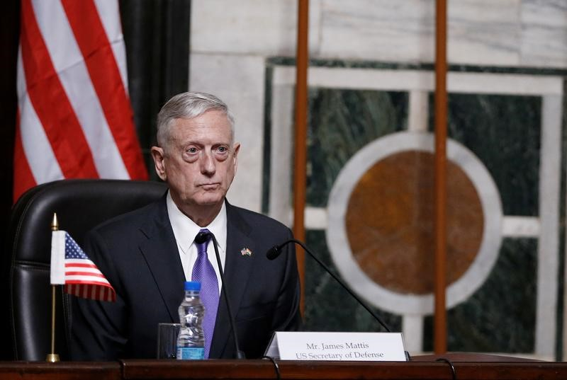 Mattis listens to question during joint news conference in New Delhi