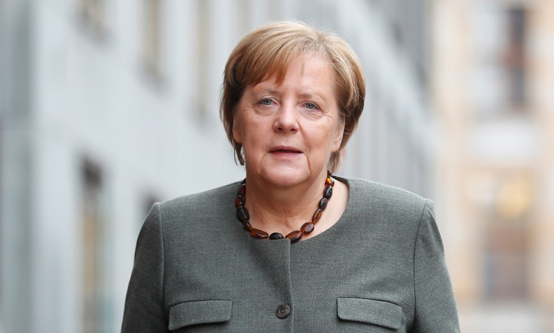 Merkel, leader of the CDU, arrives at the German Parliamentary Society offices before the start of exploratory talks about forming a new coalition government in Berlin