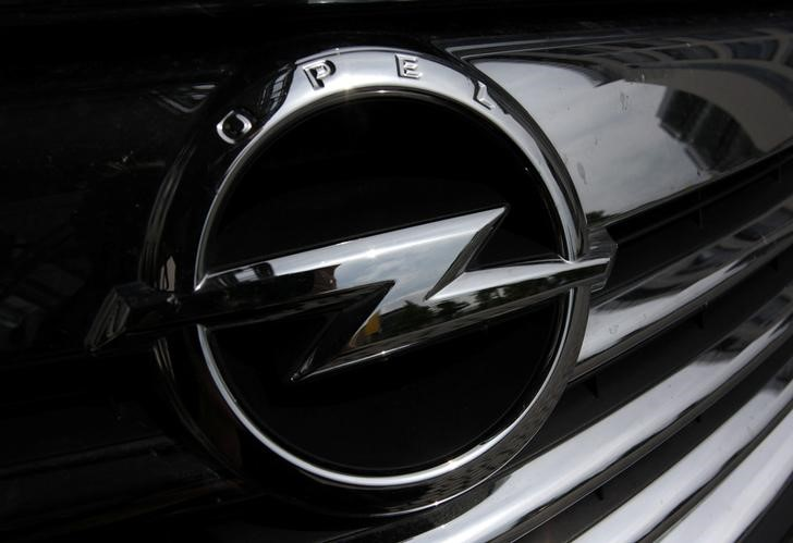 An Opel logo is pictured on a car in front of the Opel headquarters in Ruesselsheim