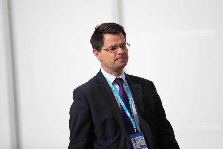 Britain's Northern Ireland Secretary James Brokenshire walks beween venues at the Conservative Party conference in Manchester