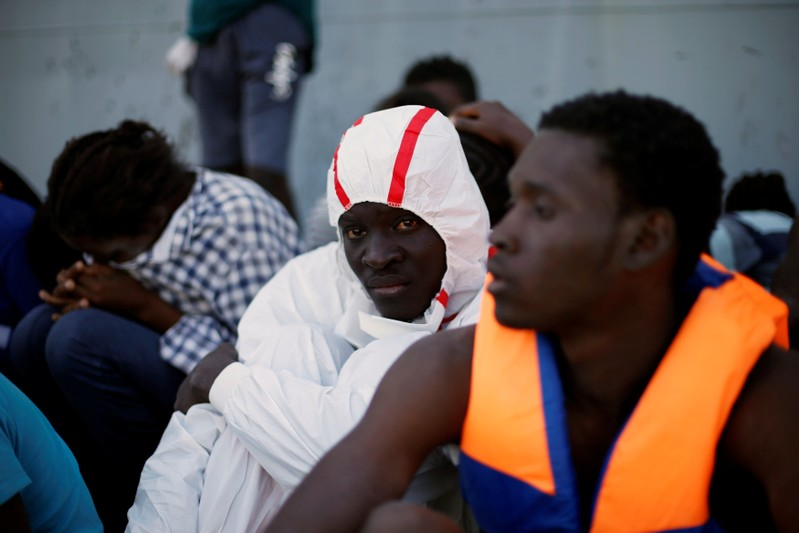 Migrants arrive at a naval base after they were rescued by Libyan coastal guards in Tripoli