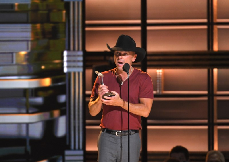Kenny Chesney accepts the Pinnacle Award at the 50th Annual Country Music Association Awards in Nashville
