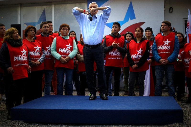 Chilean conservative presidential candidate Sebastian Pinera gestures during a campaign rally in Santiago