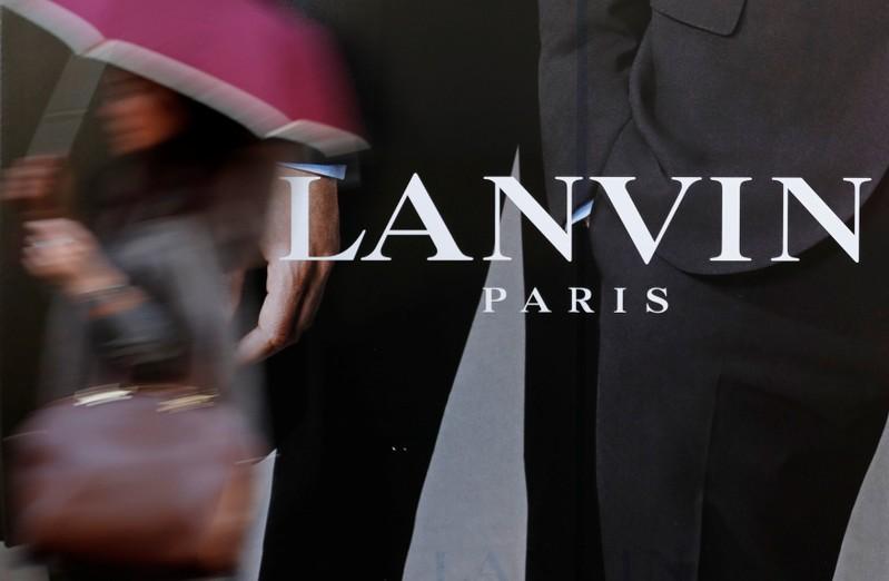 FILE PHOTO: A woman walks past a Lanvin store in Paris