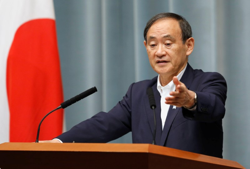 Japan's Chief Cabinet Secretary Suga attends a news conference after the launch of a North Korean missile at Prime Minister Shinzo Abe's official residence in Tokyo