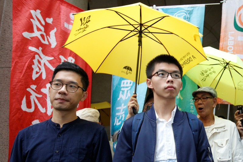 Pro-democracy activists Joshua Wong (R) and Nathan Law arrive at the Court of Final Appeal in Hong Kong