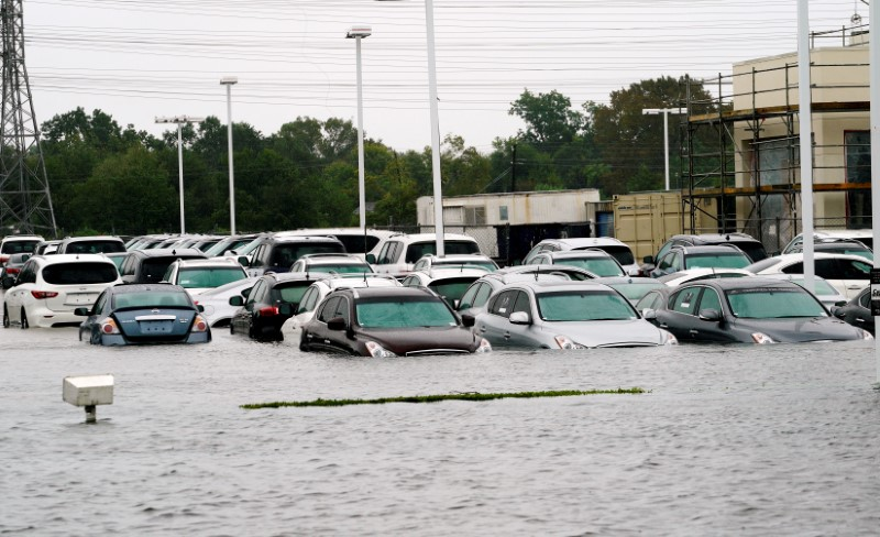 FILE PHOTO: A car dealership is covered by Hurricane Harvey floodwaters near Houston