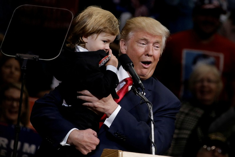 FILE PHOTO: Republican U.S. presidential nominee Donald Trump holds a child dressed as Trump at a campaign rally in Wilkes-Barre