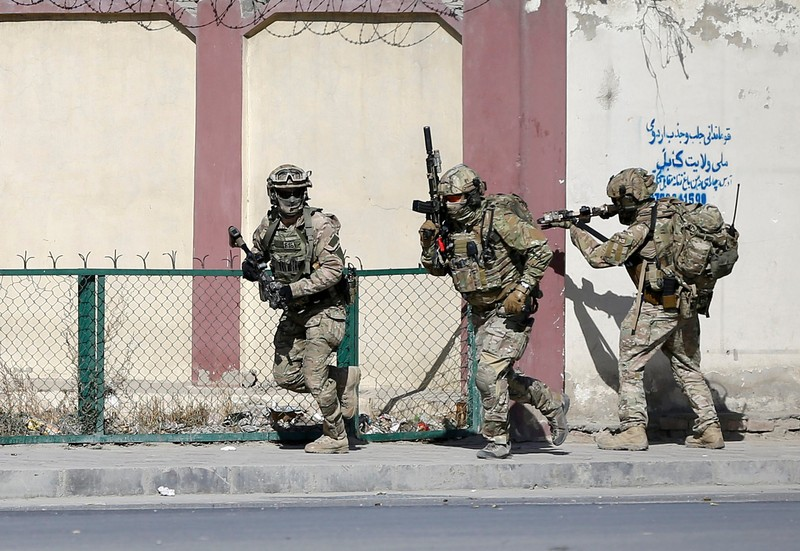 Afghan and foreign security forces arrive at the site of the attack in Kabul