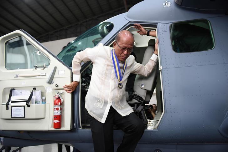 Philippine Defence Secretary Delfin Lorenzana disembarks from the cockpit of a Cessna-208B Grand Caravan Intelligence, Surveillance and Reconnaissance (ISR) aircraft in Manila
